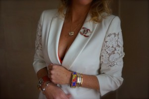 BCBG jacket, Chanel brooch, Hermes and Cartier bracelets