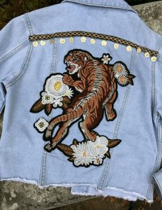 KIss the Sky denim jacket with Tiger embellishment