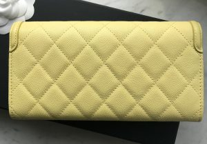 Chanel yellow caviar wallet